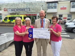 Harts Lions Presenting a checque to The Prostate Fund