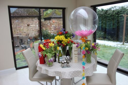 Beautiful table set with sanwhiches and balloons